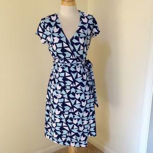 PattyBoutik large faux wrap short sleeve dress.